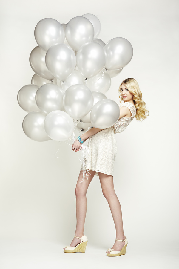 Lively cute girl holding balloons Stock Photo 05