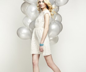 Lively cute girl holding balloons Stock Photo 06