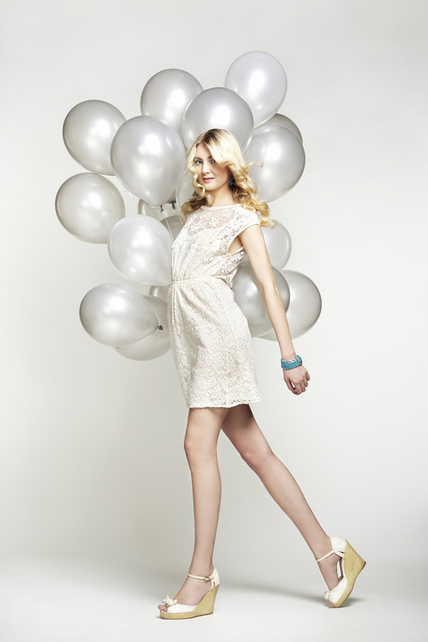 Lively cute girl holding balloons Stock Photo 07