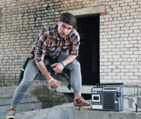 Man and vintage tape recorder Stock Photo