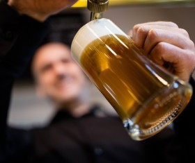 Man hands with beer close-up Stock Photo 02