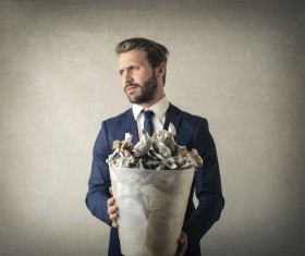 Man holding a trash can Stock Photo