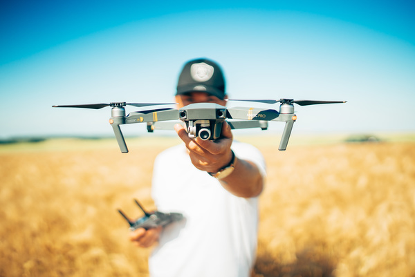 Man holding small drone Stock Photo