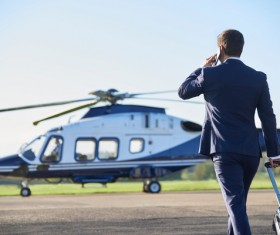 Man preparing to ride helicopter Stock Photo