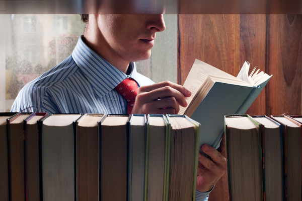 Man reading in a library Stock Photo