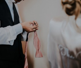 Man tying a bow tie Stock Photo