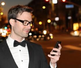 Man using smart phone Stock Photo 02