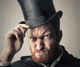 Man wearing a black top hat Stock Photo