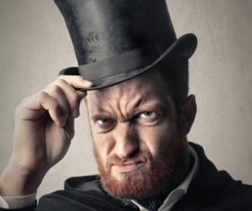 Man wearing a black top hat Stock Photo