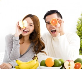 Men and women holding fruits Stock Photo