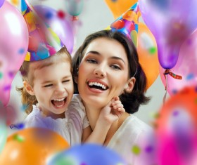 Mom celebrates her daughters birthday Stock Photo 01