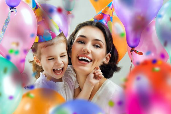 Mom celebrates her daughters birthday Stock Photo 01