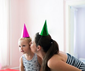 Mom celebrates her daughters birthday Stock Photo 02