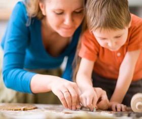 Mother teaching children to cook Stock Photo