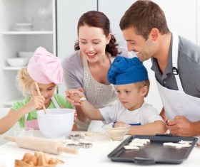 Parents and children cooking in the kitchen Stock Photo 01