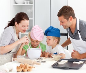 Parents and children cooking in the kitchen Stock Photo 02