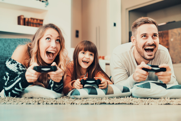 Parents play video games with their children Stock Photo 01