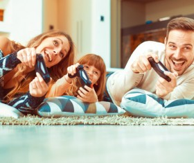 Parents play video games with their children Stock Photo 02