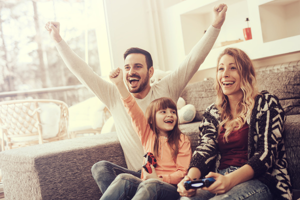 Parents play video games with their children Stock Photo 03