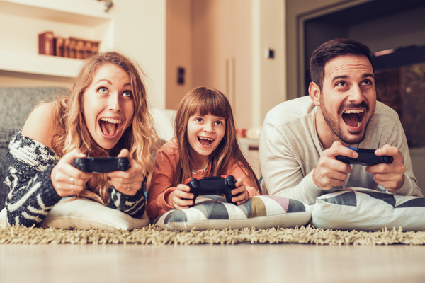 Parents play video games with their children Stock Photo 05