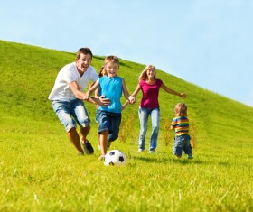 Parents with children playing football Stock Photo