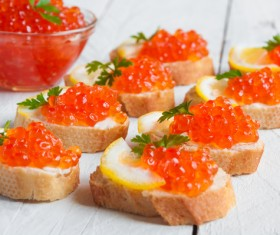 Red caviar on bread with lemon and parsley Stock Photo 01