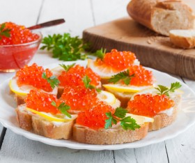 Red caviar on bread with lemon and parsley Stock Photo 05