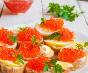 Red caviar on bread with lemon and parsley Stock Photo 08
