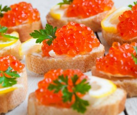 Red caviar on bread with lemon and parsley Stock Photo 11