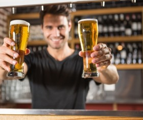 Serving waiter with beer Stock Photo
