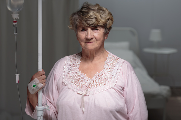 Sick elderly infusion Stock Photo