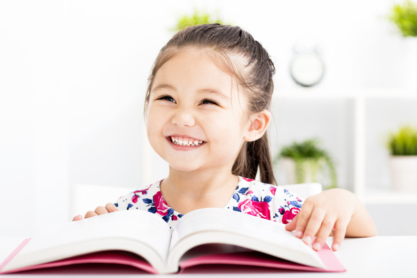 Smiling little girl and book Stock Photo