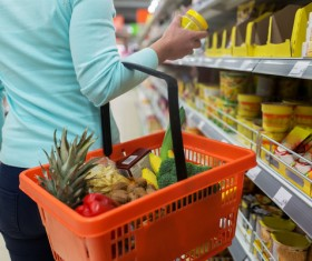 Supermarket woman buying food Stock Photo 01