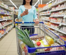 Supermarket woman buying food Stock Photo 02