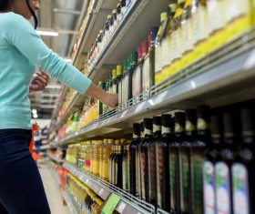 Supermarket woman buying food Stock Photo 03