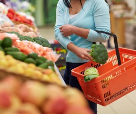 Supermarket woman buying food Stock Photo 04
