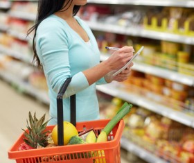 Supermarket woman buying food Stock Photo 11