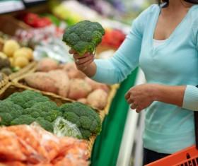 Supermarket woman buying food Stock Photo 13