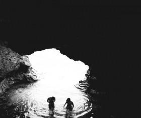 Swimming in a cave people Stock Photo