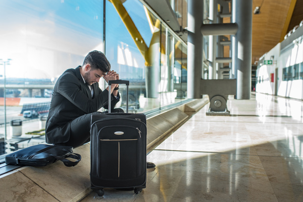 Tired man sitting on the ground resting Stock Photo