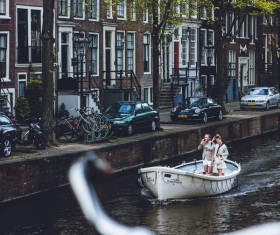 Tourists enjoy boating on river in city Stock Photo