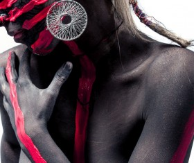 Tribal black person decorated with paint Stock Photo