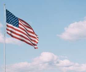 Usa flag waving on cloud sky Stock Photo
