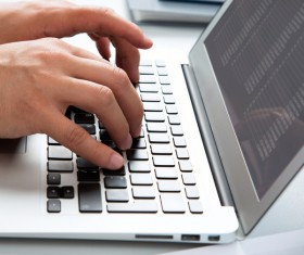 Use laptop to query data Stock Photo 01