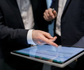 Using Tablet PC for Business Data Analysis Stock Photo 01