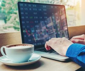 Using laptops to stocks Stock Photo