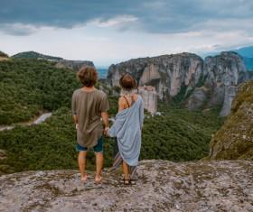 Watching beautiful mountain landscape Couple Stock Photo