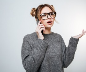 Wearing broad-brimmed glasses girl answered the phone Stock Photo