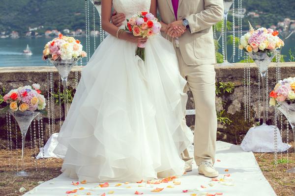 Wedding bouquet in hands of woman Stock Photo