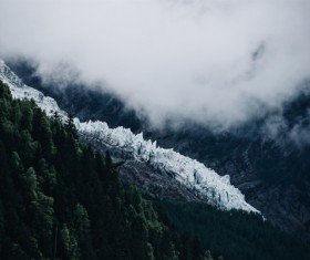 White fog on snowy mountain scene Stock Photo